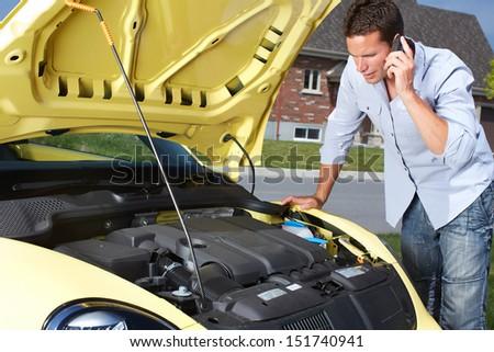 Man near broken car. Auto repair service concept. - stock photo