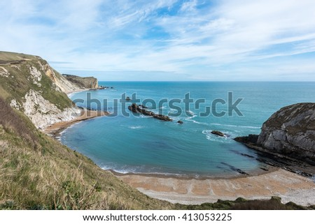 Man 'O war beach, a popular beach of sand and fine pebbles on the east side of Durdle Door - stock photo