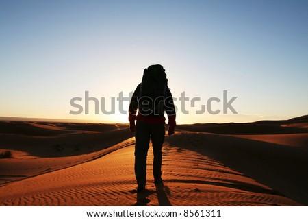 Man observer  sand desert - stock photo