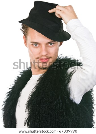man of fashion in trendy vest and hat