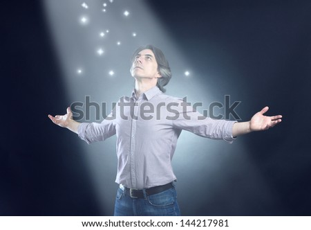 man of freedom open arms and mystical light - stock photo