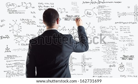 Man of science writing physics and chemistry formulas over a white background - stock photo