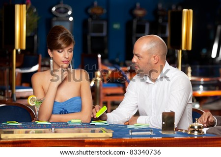 man offering a casino chip to lady - stock photo