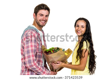 Man offering bouquet to his girlfriend on white screen - stock photo