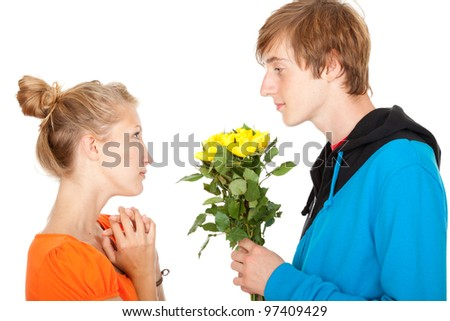 man offering flowers to his girlfriend, white background - stock photo