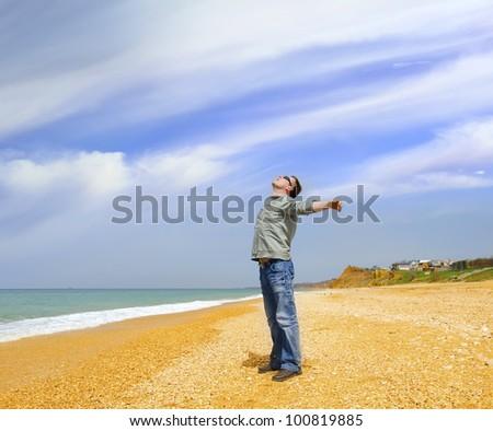 man on a beach - stock photo