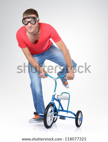 Man on a children's bicycle - stock photo