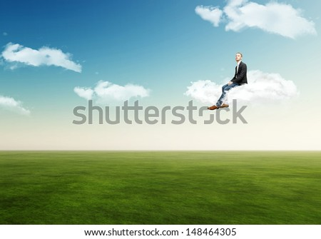 man on a cloud  - stock photo