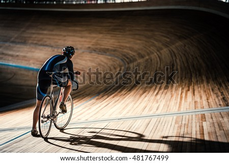Man on a cycle indoors