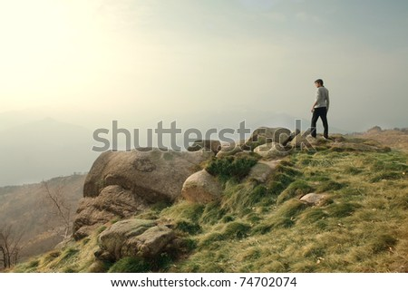 Man on a hill - stock photo
