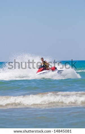 man on a jet-ski, making splashes - stock photo