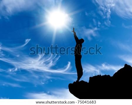 man on a mountain top - stock photo
