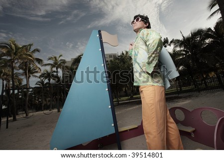 Man on a playground sailboat