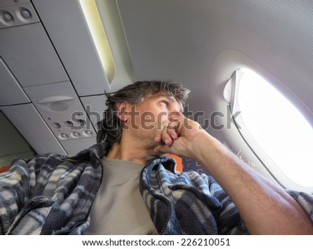 man on an airplane, Concept photo of air travel - stock photo