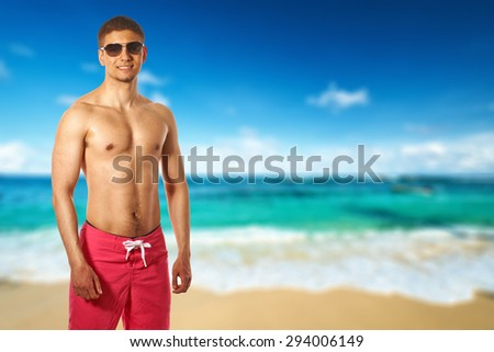 Man on beach at Seychelles, Mahe. Collage. - stock photo