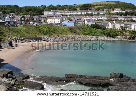 man on beach in new quay, wales ,looking out to sea
