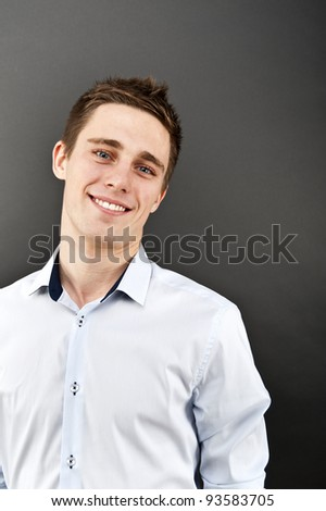 man on black background in shirt - stock photo
