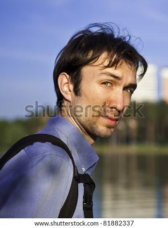 man on blue sky background - stock photo
