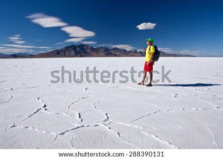 Man on Bonneville salt flats - USA - stock photo