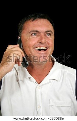 Man on cell phone laughing and listening. - stock photo