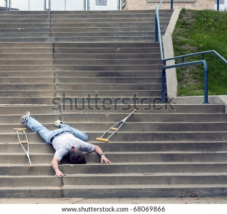 man on crutches fell on stairs outside