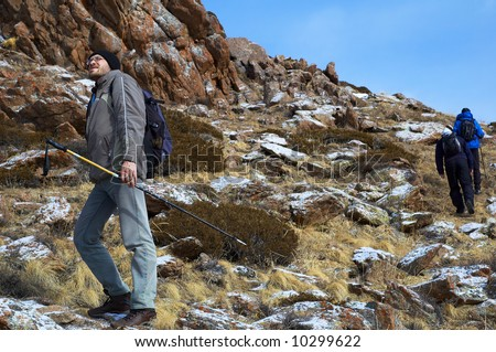 Man on footpath in high mountain - stock photo