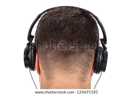 man on his back with headphones on head - stock photo