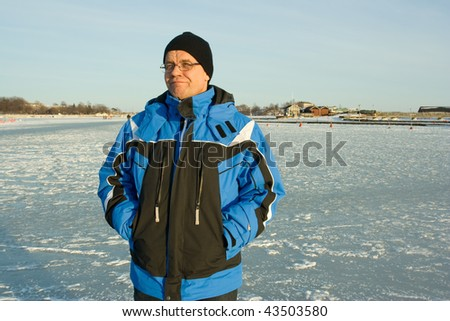 Man on ice with a funny expression - stock photo
