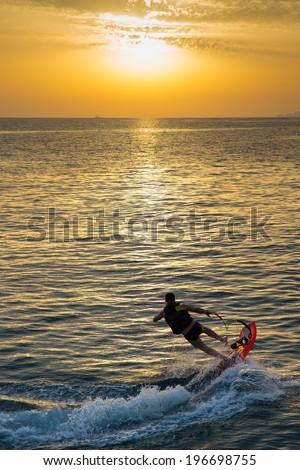 man on jet surf jump on the wave  - stock photo