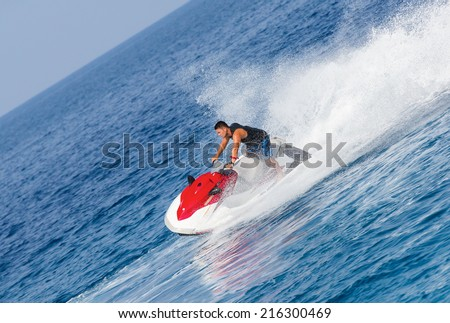 man on jetski jump on the wave