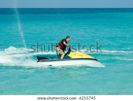 Man on jetski taking a ride on the ocean