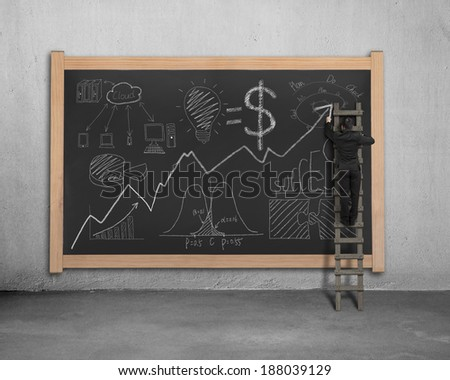 Man on ladder drawing business concept doodles on blackboard - stock photo
