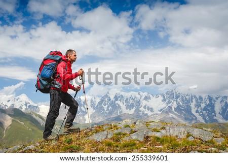 Man on mountain hike. Caucasus mountains - stock photo