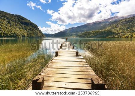 Man on mountains lake - stock photo