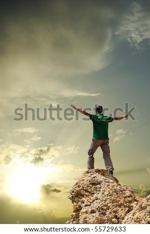 Man on peak of mountain. Conceptual design. - stock photo