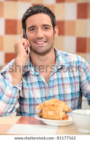 Man on phone at breakfast