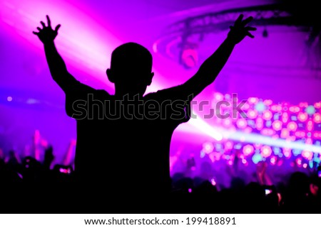 Man on shoulders in nightclub party silhouette - stock photo