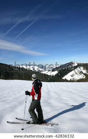 Man on skis face to a snowy landscape - stock photo