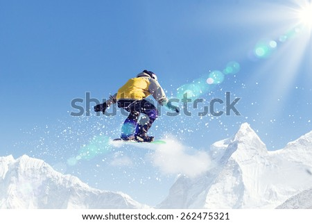 Man on snowboard jumping in sky. Summer vacation - stock photo