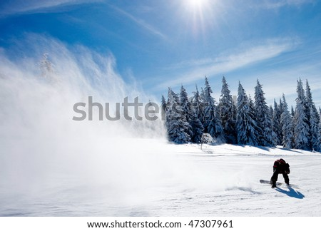 Man on snowboard making big splash of snow - stock photo