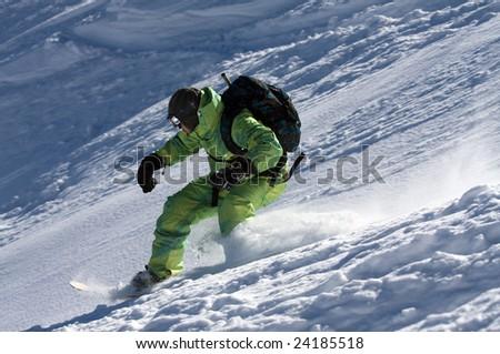 Man on snowboard ride in powder - stock photo
