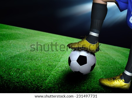 man on soccer field and the bright lights - stock photo