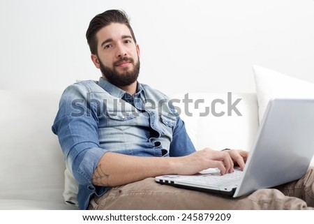 man on sofa with laptop