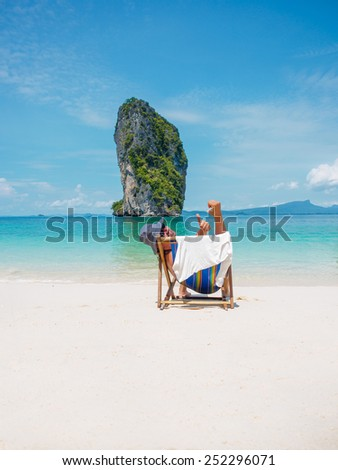 Man on the beach in Thailand Winter holidays in the sun - stock photo