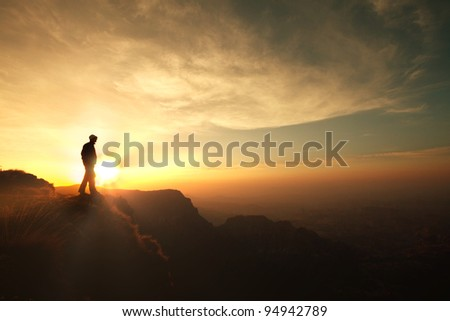 man on the cliff - stock photo