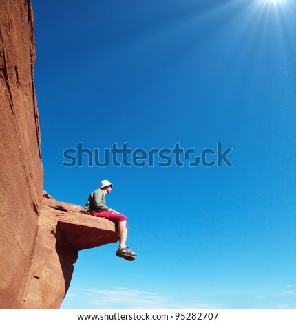 Man on the cliff in Glen Canyon