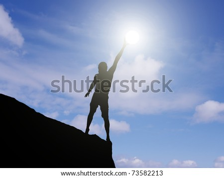man on the edge of a cliff stretches towards the sun - stock photo
