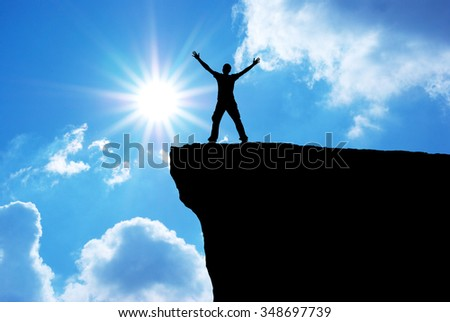 Man on the mountain edge. Conceptual scene. - stock photo