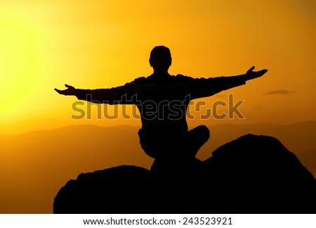 Man on the mountain in the evening - stock photo