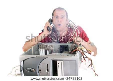 man on the phone trying reach hotline while smoke is coming from computer - stock photo
